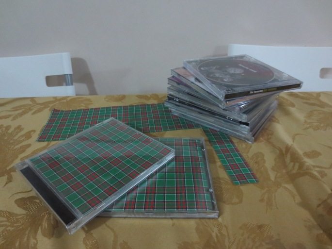 Using seasonal paper to ready the CD cases!
