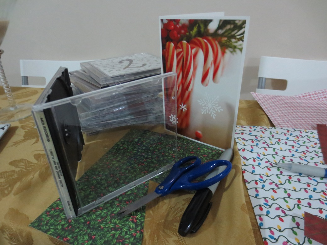 You can use old cards, wrapping paper, or decorative seasonal paper for the covers.