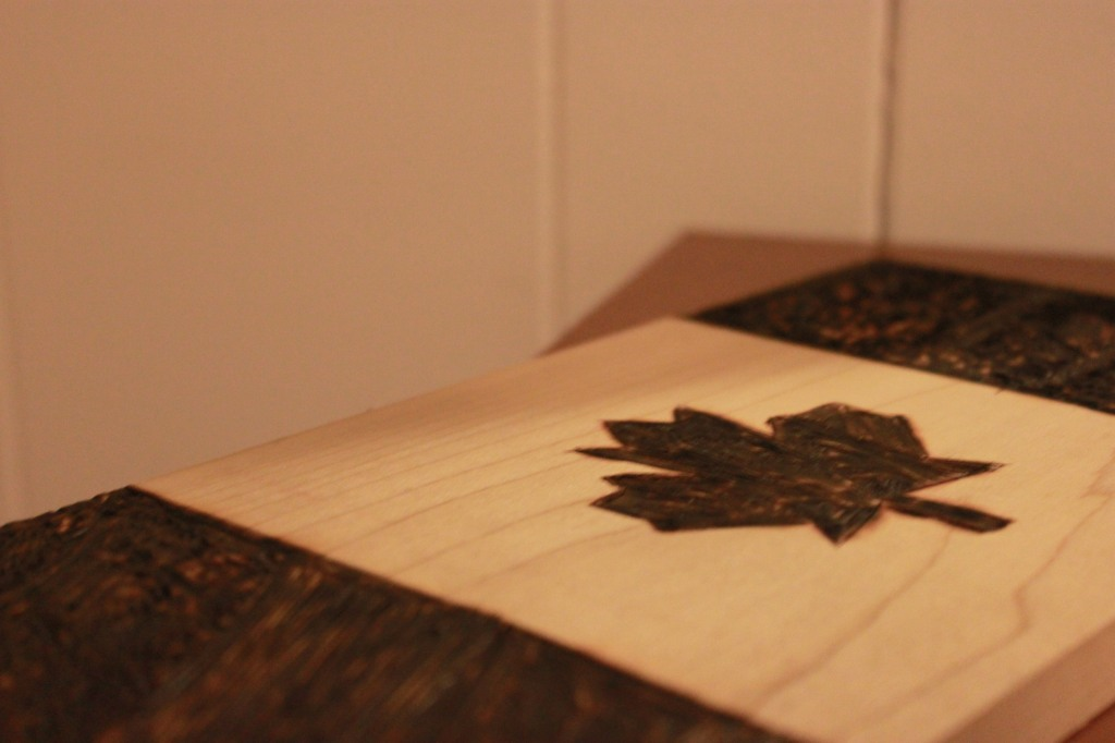 Props to my brother Mike for wood-burning my awesome Canada flag.